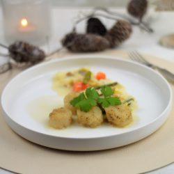 Coquilles met groenten en witte wijnsaus